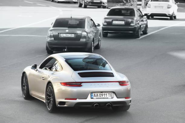 Abstract photo. Porsche 911 Carrera 4S car in motion stock photo