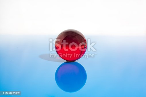 istock Abstract photo with small glass balls on transparent background. 1159462082