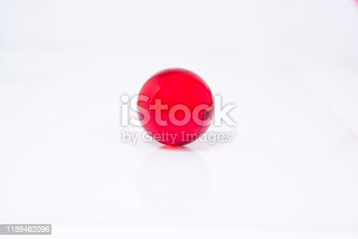 istock Abstract photo with small glass balls on transparent background. 1159462096