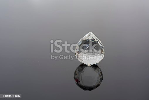 istock Abstract photo with small glass balls on transparent background. 1159462097