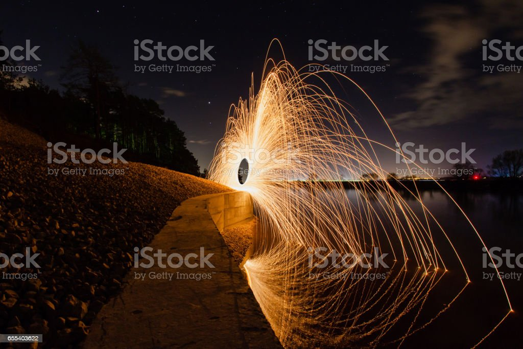 Abstract picture with trajectories of burning sparks on the surface...