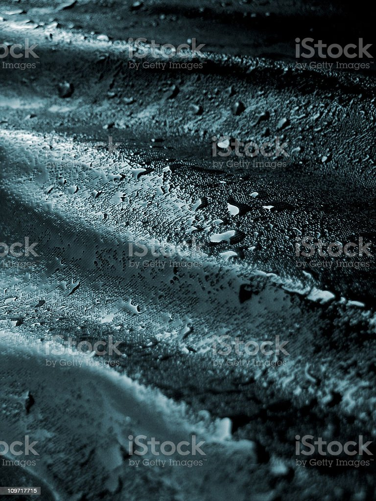 Abstract Piece of Fabric Covered in Oil and Ripples stock photo