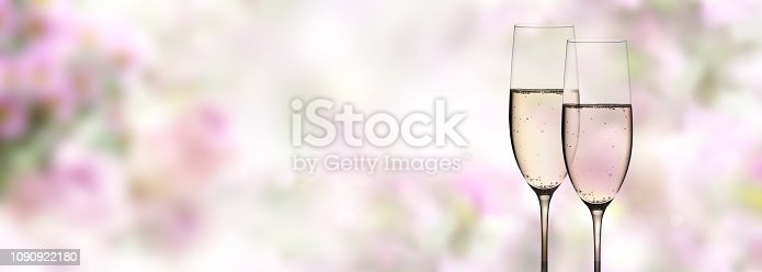 638784780 istock photo Abstract pink flowers with champagne 1090922180