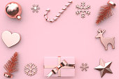 abstract pink metallic glossy-rose gold ribbon gift box snow tree heart christmas ball candy reindeer star christmas holiday new year concept 3d rendering minimal pink background