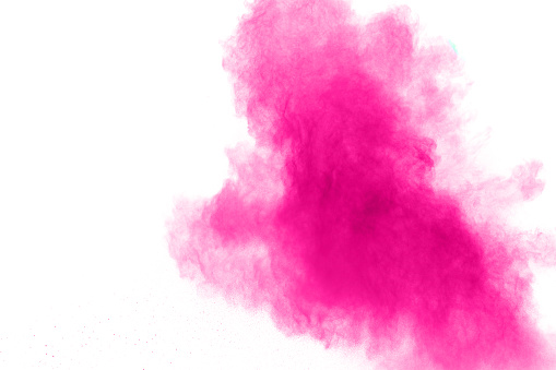 istock Abstract pink powder explosion on white background. Freeze motion of pink dust splattered. 1145044704