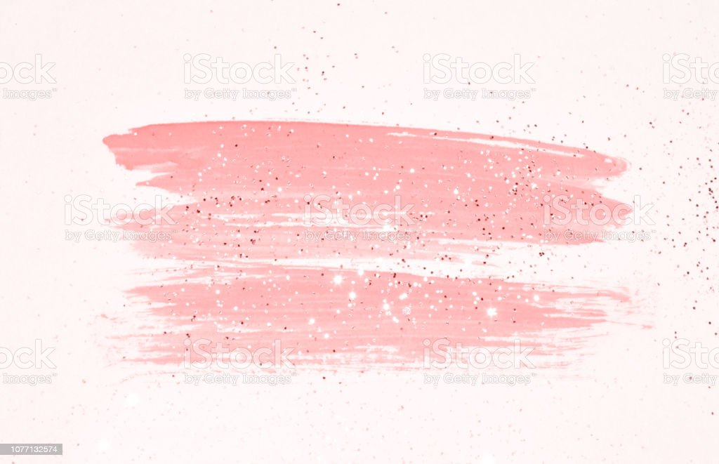 Abstract pink watercolor splash and golden glitter in vintage...