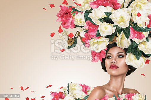 1169941952istockphoto Abstract portrait of young beautiful woman with flowers hairdo 948102004