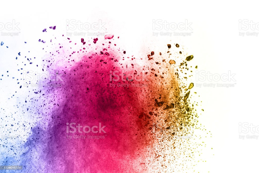 Explosion of colored powder on white background ,Freeze motion of...