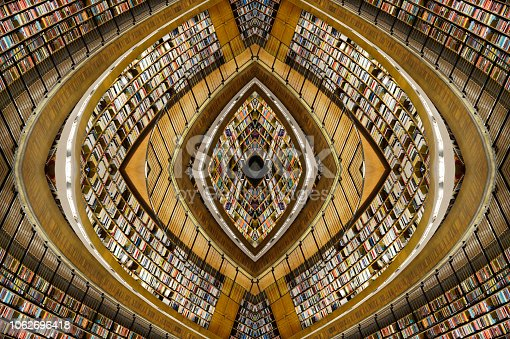 istock Abstract public library shelves design 1062696418