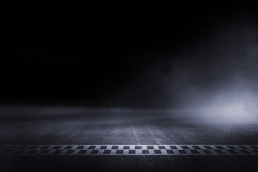 istock Abstract Race track finish line racing on light night 1072758130