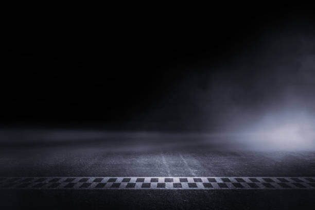 abstract race track finish line racing on light night - race stock pictures, royalty-free photos & images