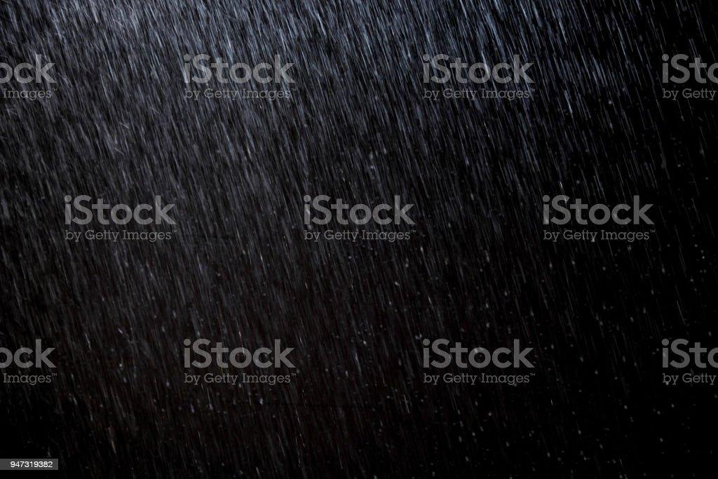 抽象的な雨テクスチャ背景。夜の光で背景雨 ストックフォト
