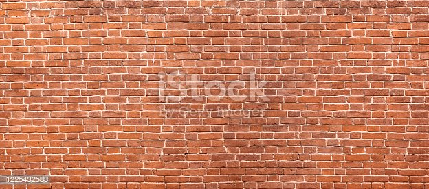 istock Abstract red brick wall panoramic background 1225432583
