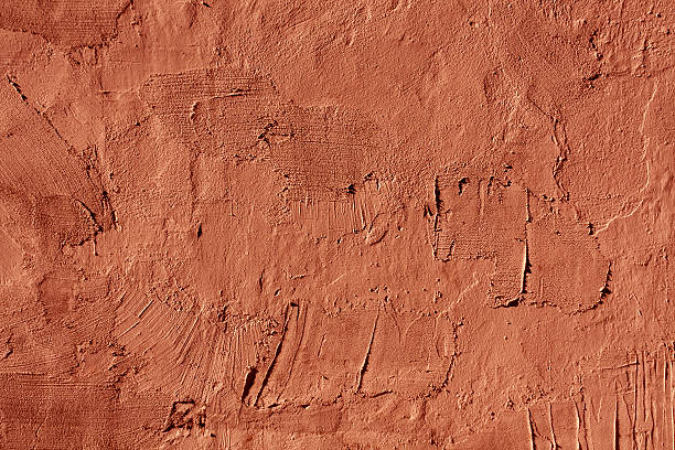Abstract red cement wall texture. Abstract red cement wall texture. Architectural background and texture for design. clay stock pictures, royalty-free photos & images