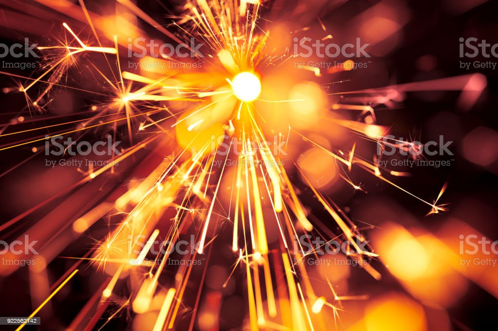 Abstract Red Centered Sparks - Sparkler Background Party New Year Celebration Technology stock photo