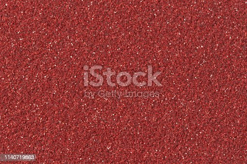 886746424 istock photo Abstract red Christmas glitter background.  Low contrast photo. 1140719863