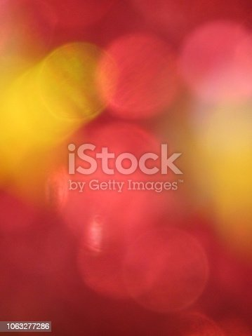 505891506 istock photo Abstract red defocused background 1063277286