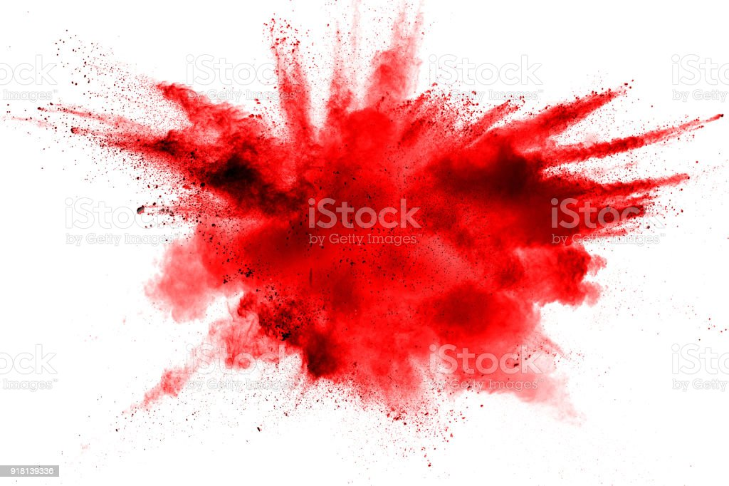 abstract red dust splattered on  white background. Red powder explosion on white background. Freeze motion of red particles splash.