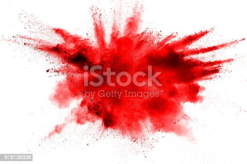 istock abstract red dust splattered on  white background. Red powder explosion on white background. Freeze motion of red particles splash. 918139336