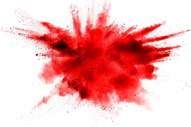 abstract red dust splattered on  white background. red powder explosion on white background. freeze motion of red particles splash. - colore descrittivo foto e immagini stock