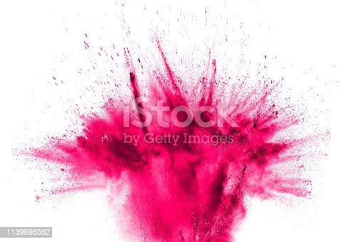 istock Abstract red dust splattered on white background. Red powder explosion.Freeze motion of red particles splashing. 1139695352