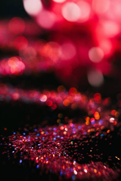 abstrakt rot glitter unscharf gestellt unschärfe bokeh - nageldesign weihnachten stock-fotos und bilder