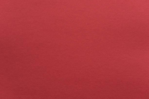Abstrakte rote Hochglanzpapier-Textur Hintergrund oder Kulisse. Leeres Packpapier oder glänzende Pappe für dekoratives Gestaltungselement. Gradfarbenaue Oberfläche für Weihnachtsurlaub oder chinesisches Neujahrskonzept – Foto