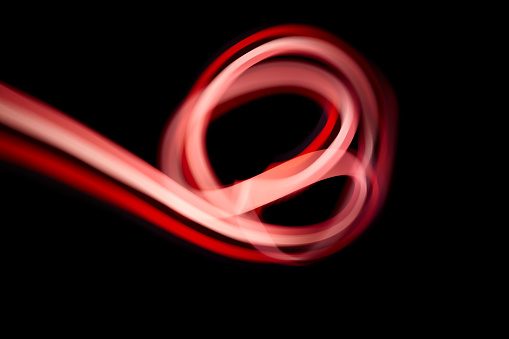 Abstract red light painting on a black background