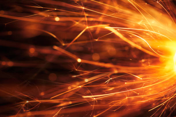 Abstract Red Sparks - Sparkler Background Party New Year Celebration Technology stock photo