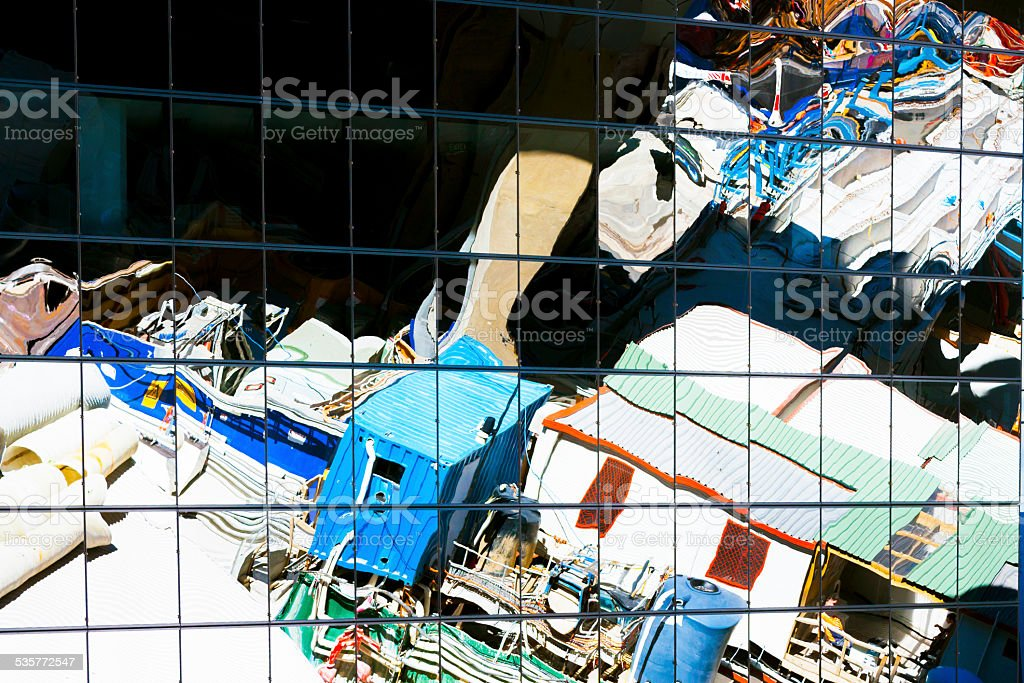 Abstract reflection of construction site on glass wall of building stock photo
