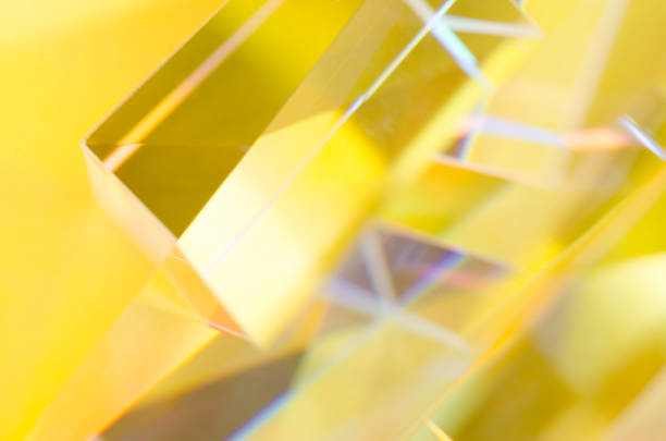 Abstract reflections of glass prisms in yellow light