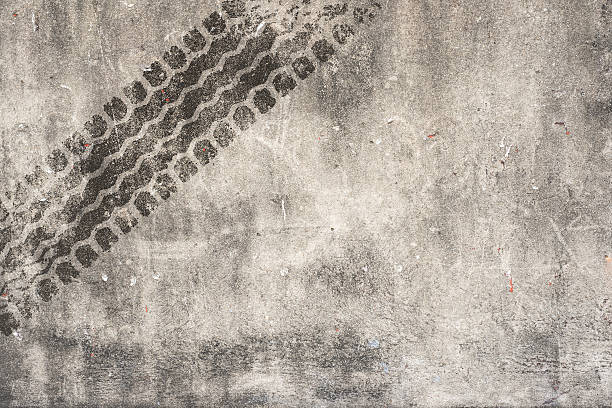 Abstract road background with tyre track Abstract road background with tyre track tire track stock pictures, royalty-free photos & images