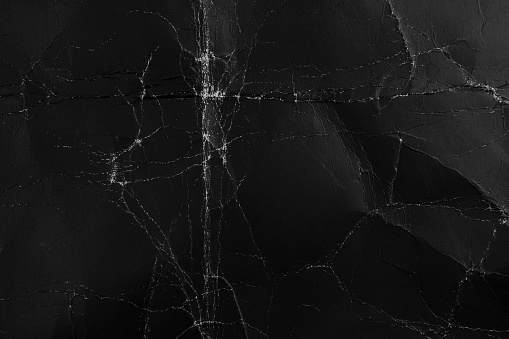 Abstract rough black background. Old packing grungy dark cardboard material. For web page design.
