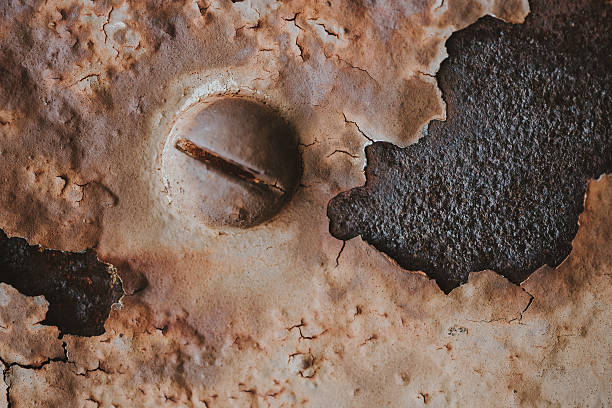 Abstract Rusty Metal Grunge Background with Bolt stock photo