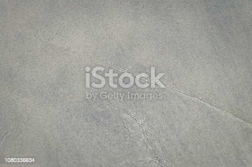 825992650 istock photo abstract sand of beach and soft wave background 1080336634