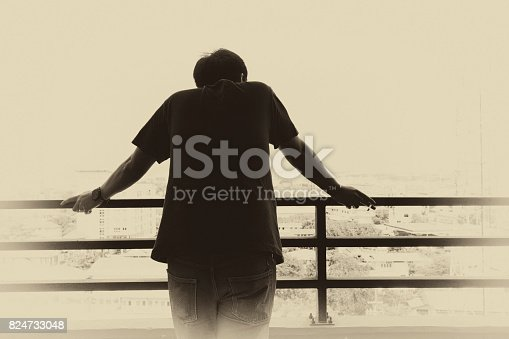 istock abstract scene man stand back and keep cigarette in vintage black & white filter 824733048