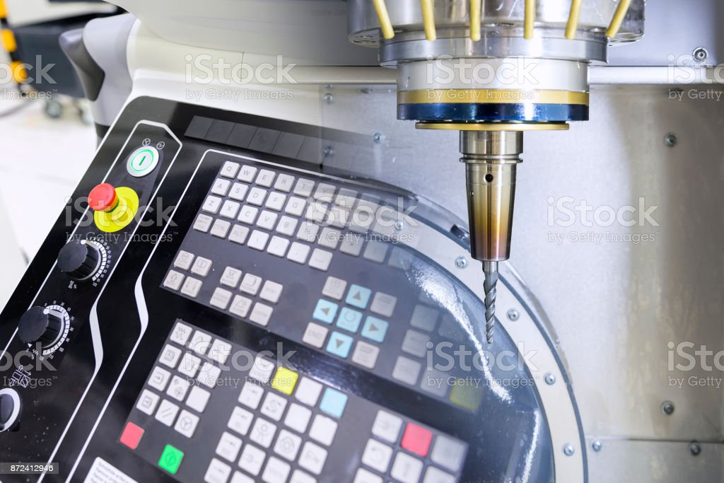 Abstract scene of The 5 axis CNC machine and the control panel stock photo