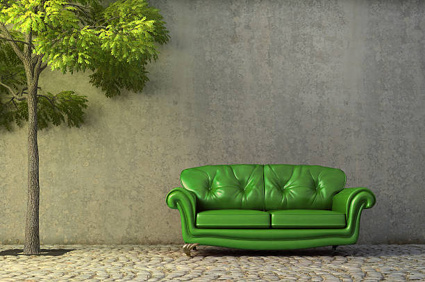 Abstract scene with couch on a side walk stock photo