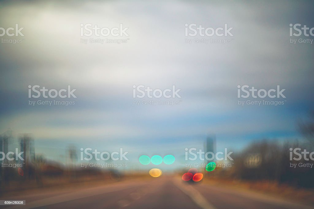 Abstract scenic background with road, car lights and traffic lights stock photo