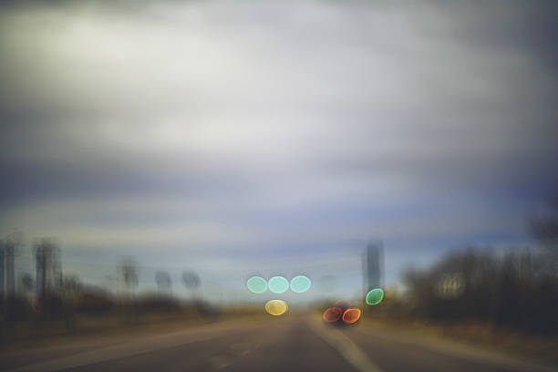 abstract scenic background with road, car lights and traffic lights - soft focus stock photos and pictures