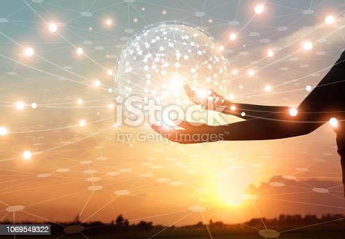 istock Abstract science, circle global network connection communication in hands on sunset background, technology and innovation. 1069549322