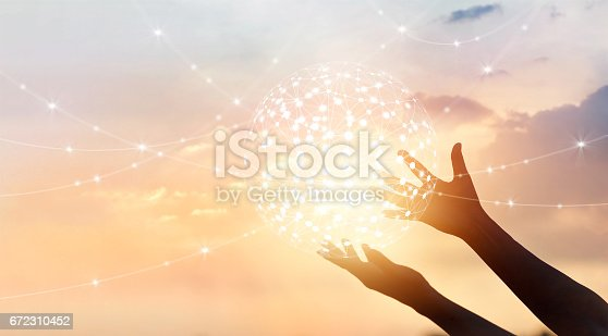 istock Abstract science, circle global network connection in hands on sunset background 672310452