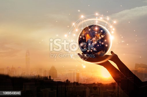istock Abstract science, hands touching earth and circle global network connection communication on sunset background, technology and innovation. Elements of this image furnished by NASA 1069549340