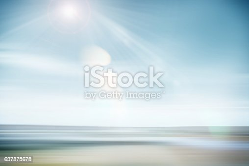 Abstract seascape with panning motion combined with a long exposure. Image displays soft, pastel colors in a retro style.