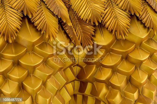Abstract seamless geometrical wavy background from golden metal shaped and banners with ethnic patterns. Art decor wallpaper style of the tropics. Palm leaves of tropical plant creative composition