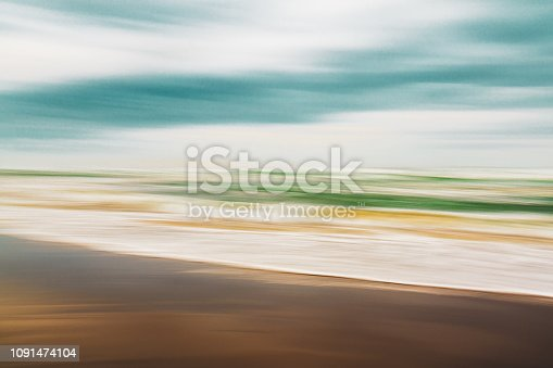 1145124060istockphoto Abstract seascape, blurred motion, sunny day on the beach 1091474104