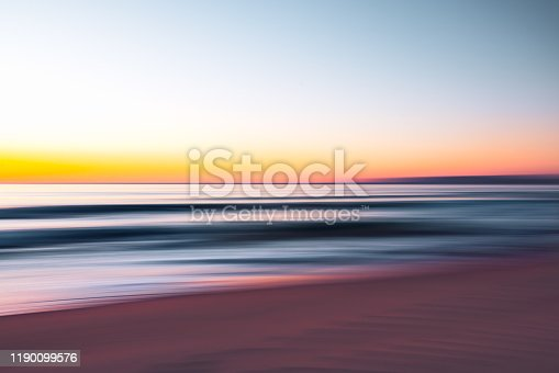 528963376 istock photo Abstract seascape. Sunrise over the sea. Motion blur, play of ripples.  Pink, yellow, purple, and  blue colors 1190099576