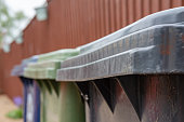 istock Abstract, shallow focus image of a trio of wheelie bins used for specific household waste. 953126634