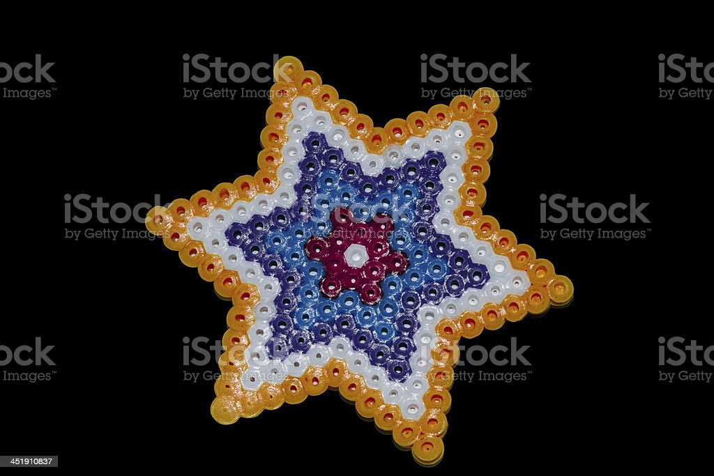 abstract shape of plastic beads pieced by child stock photo