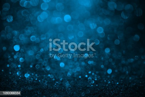 istock Abstract Shiny Blue Background 1050066334